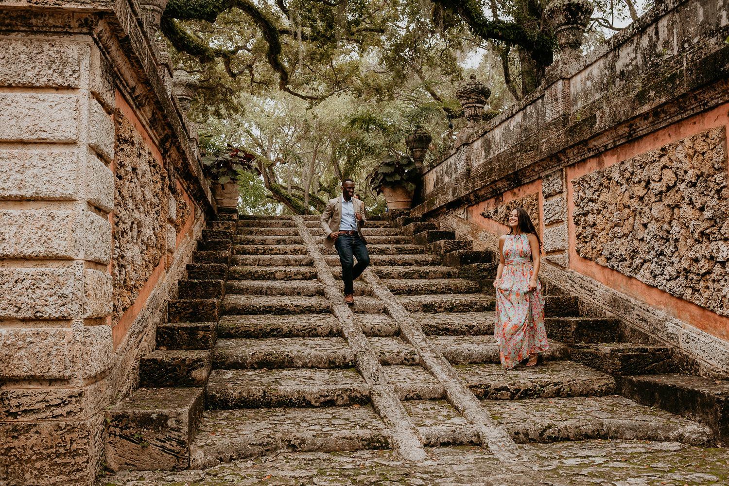 guy running towards woman down stone steps at vizcaya museum