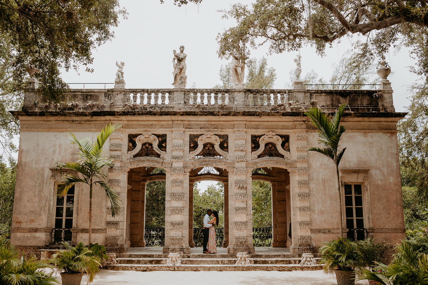vizcaya stone castle with engaged couple hugging in the middle