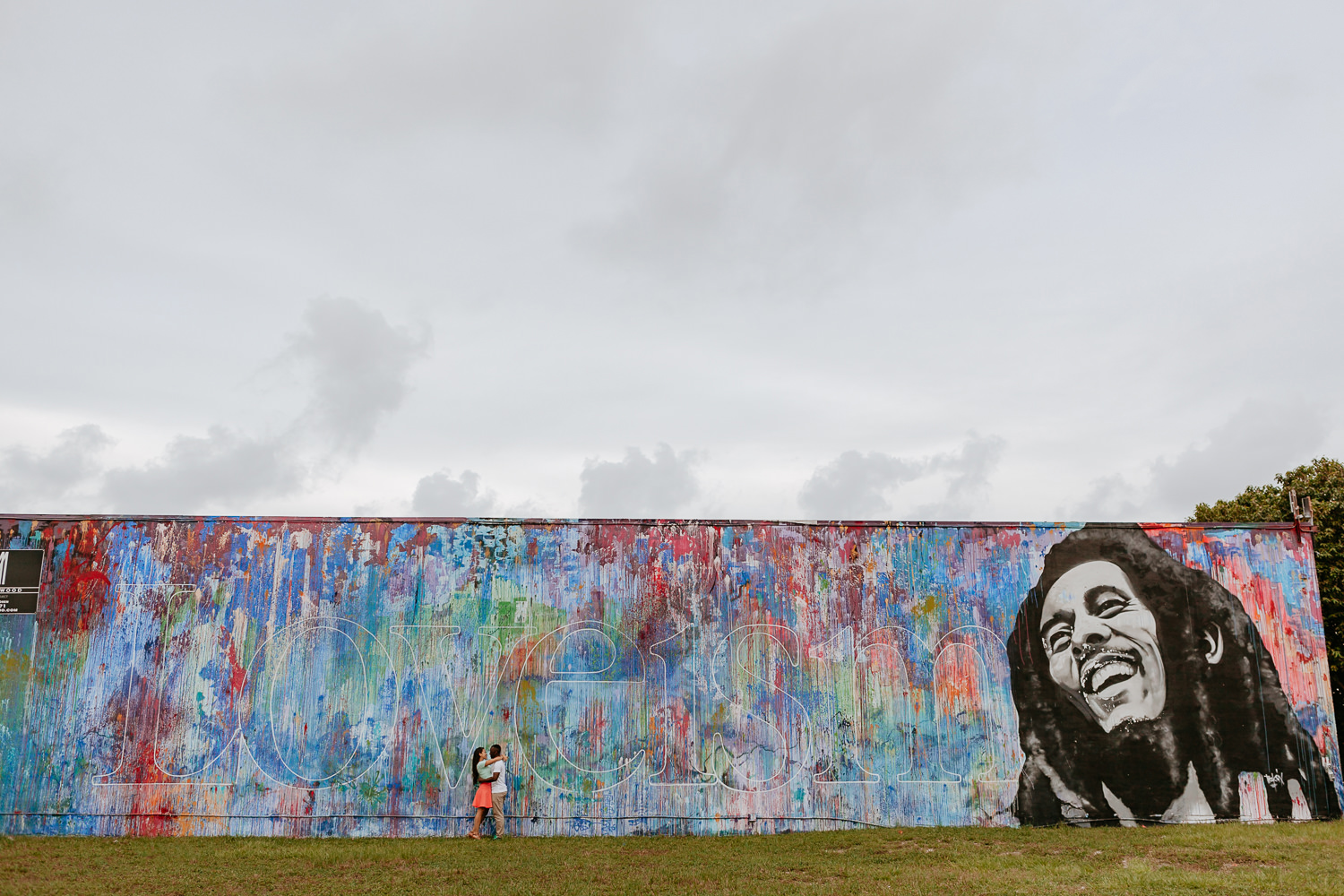 bob Marley Wynwood wall with engaged couple hugging in the middle