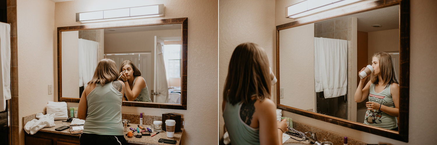 bride doing her makeup in the hotel bathroom mirror