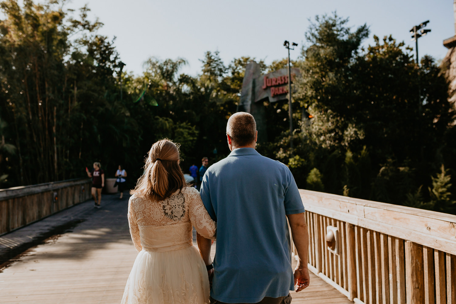 bride and her father walking on Universal Studios bridge