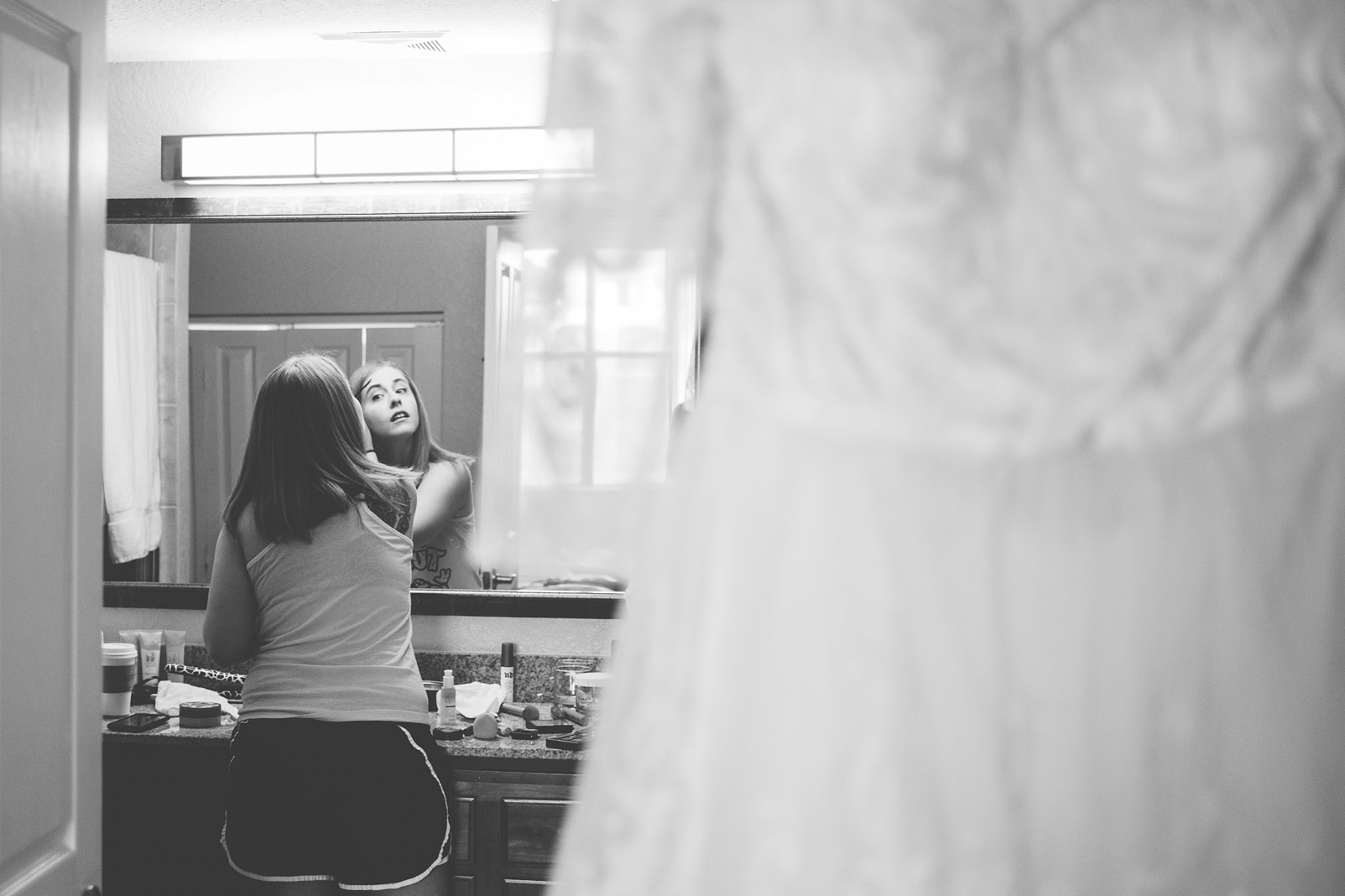 bride putting on make up black and white