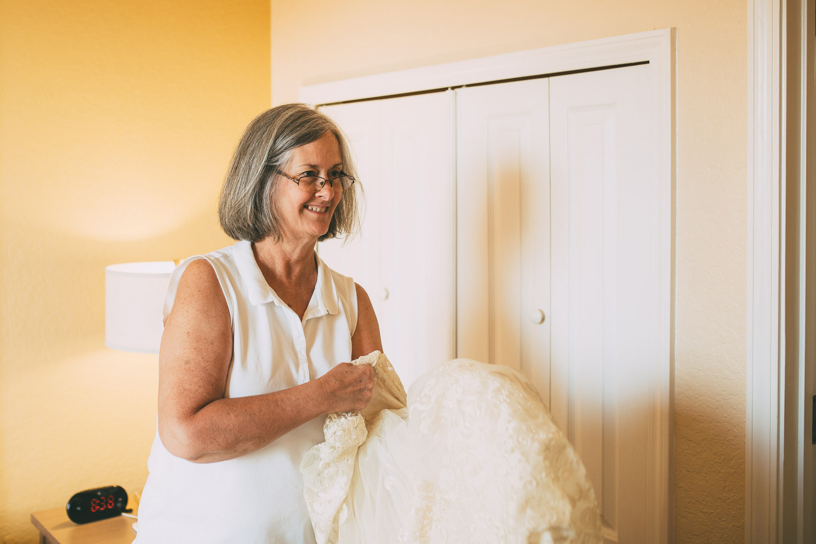 brides mom holding dress