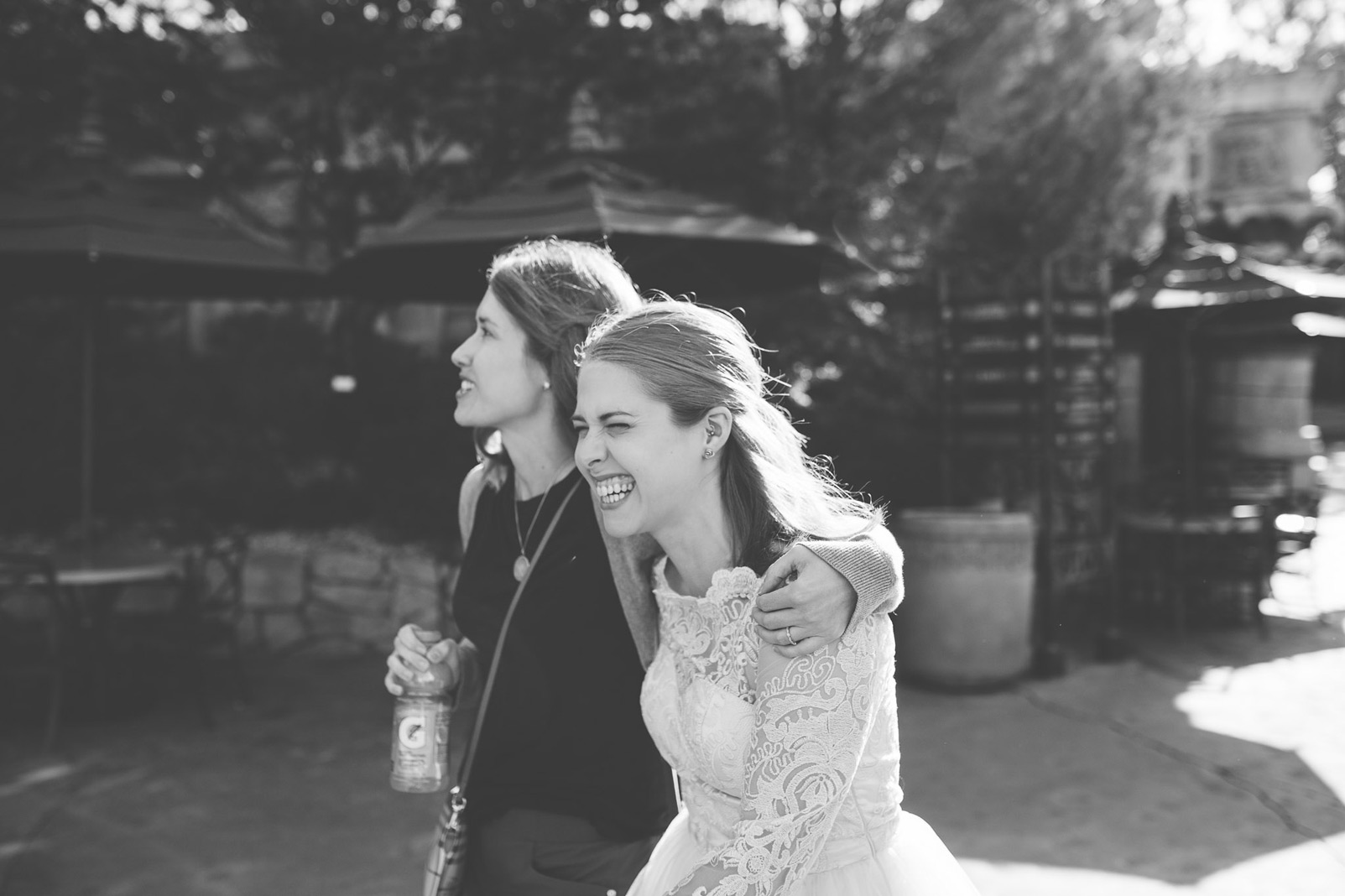 bride and sister hugging black and white