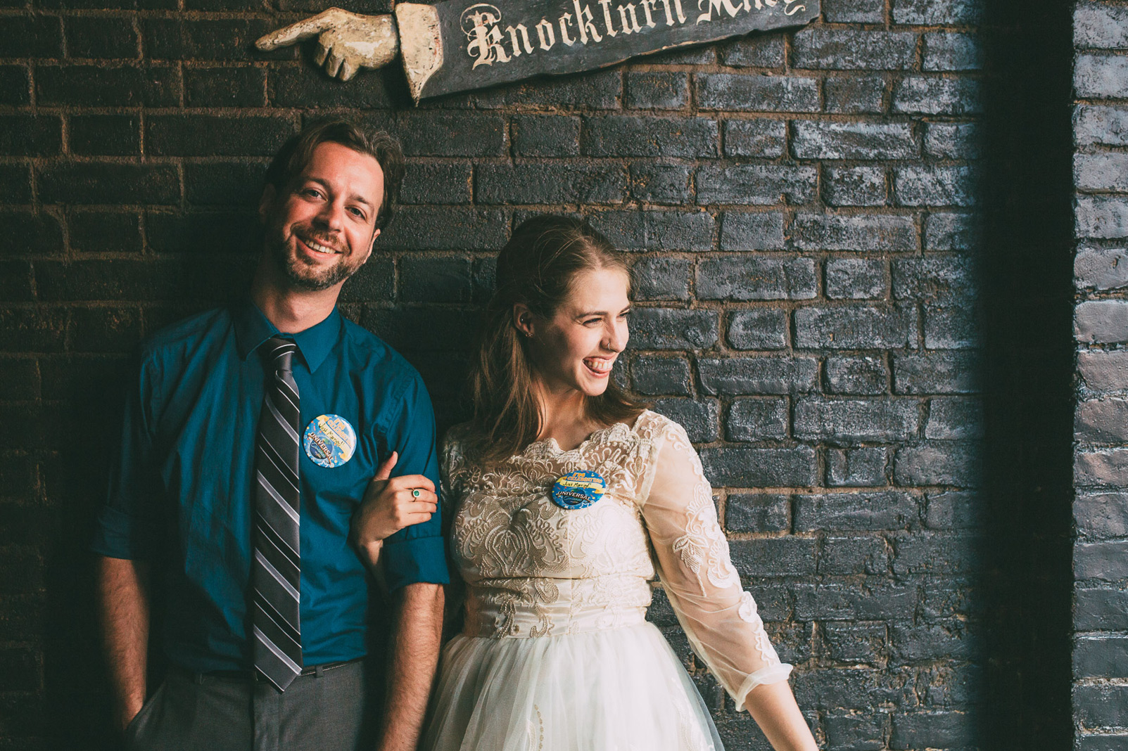 bride and groom under knockturn alley sign silly face