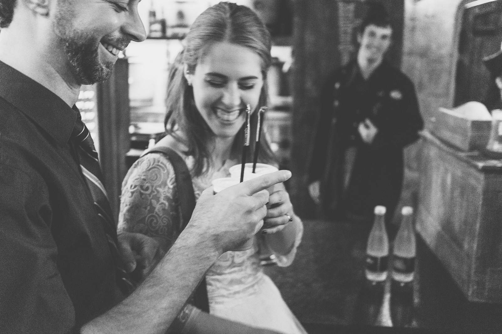 newlyweds cheering with butter beer black and white