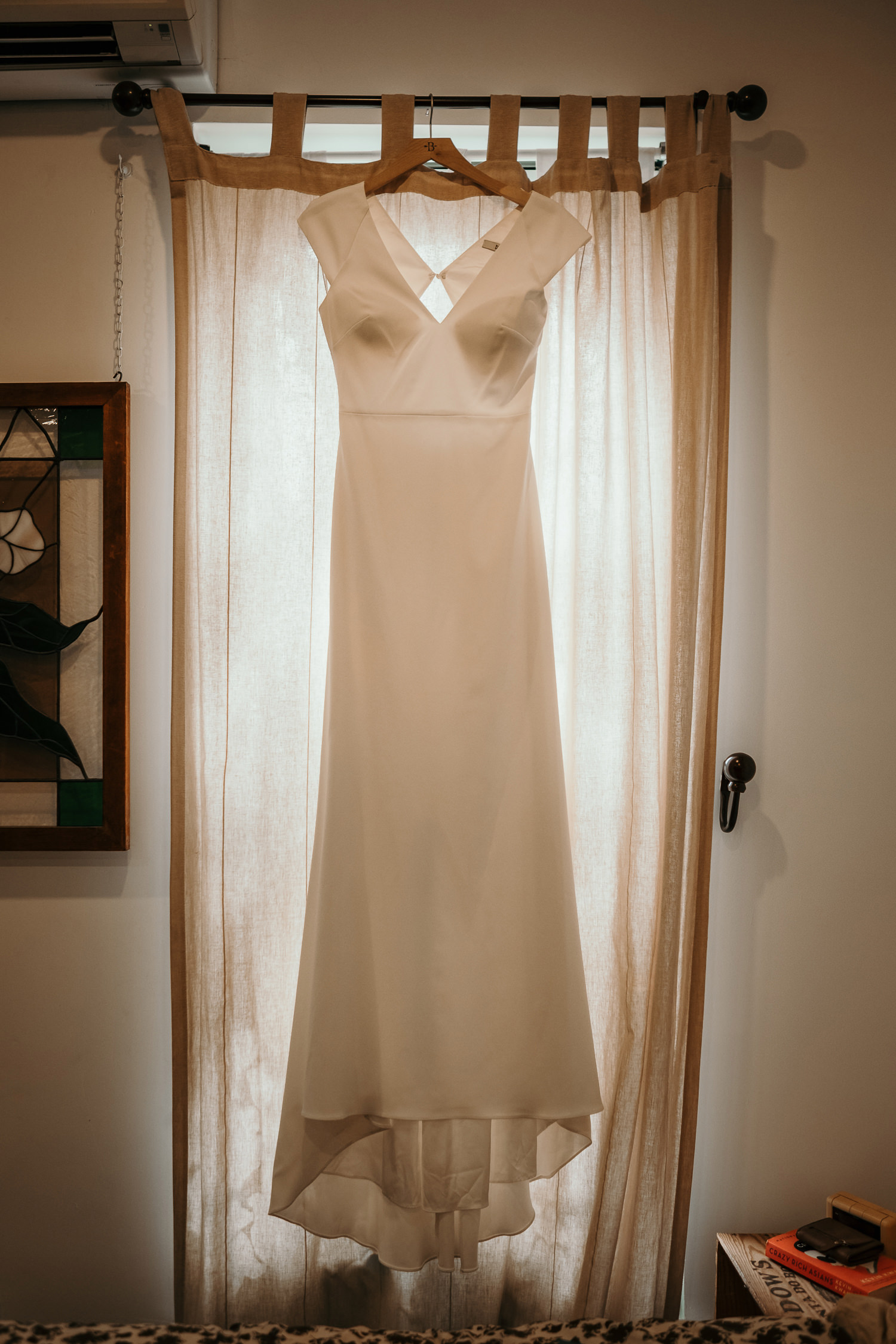 dress hanging on window with back light