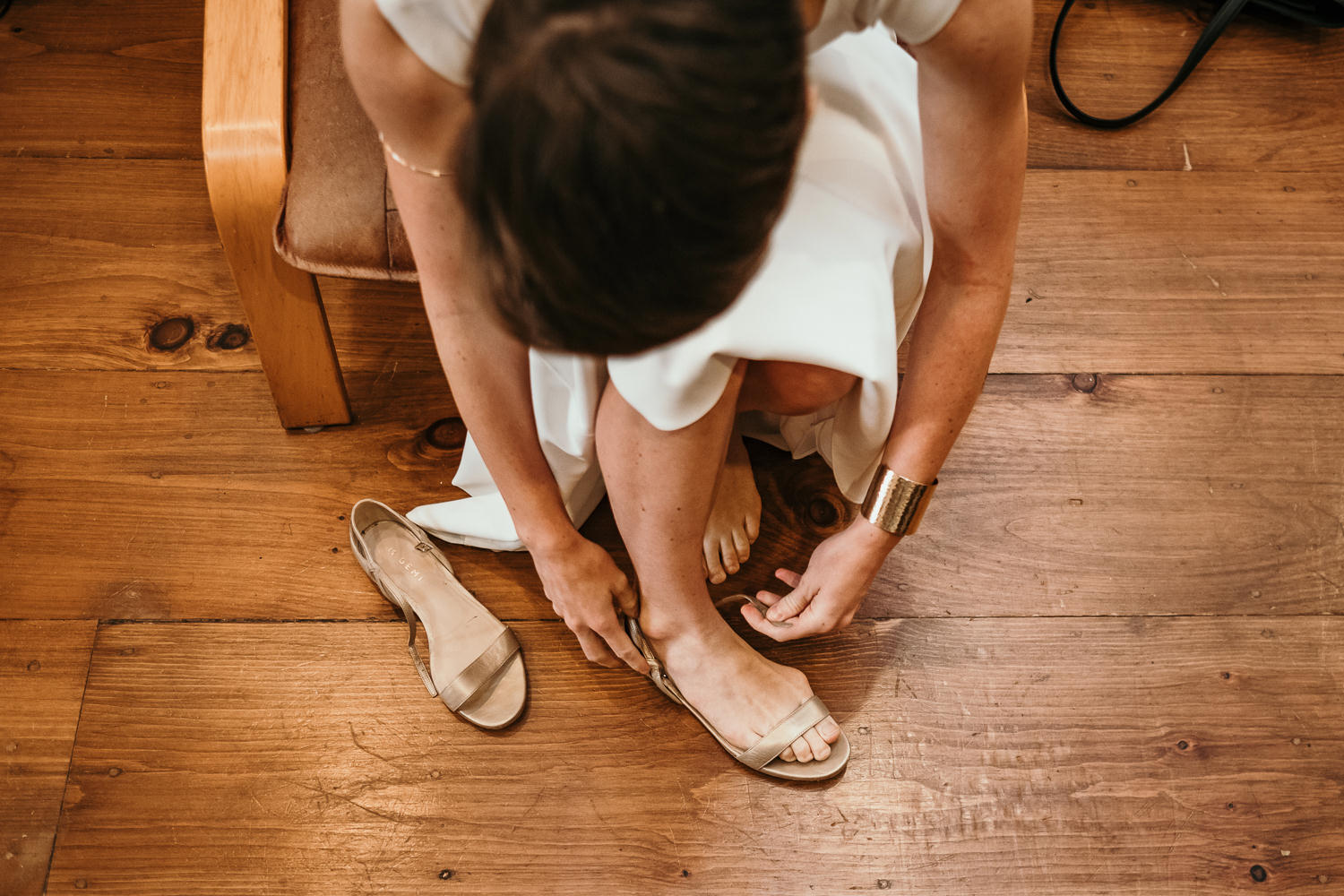 overhead shot of bride putting on her shoes