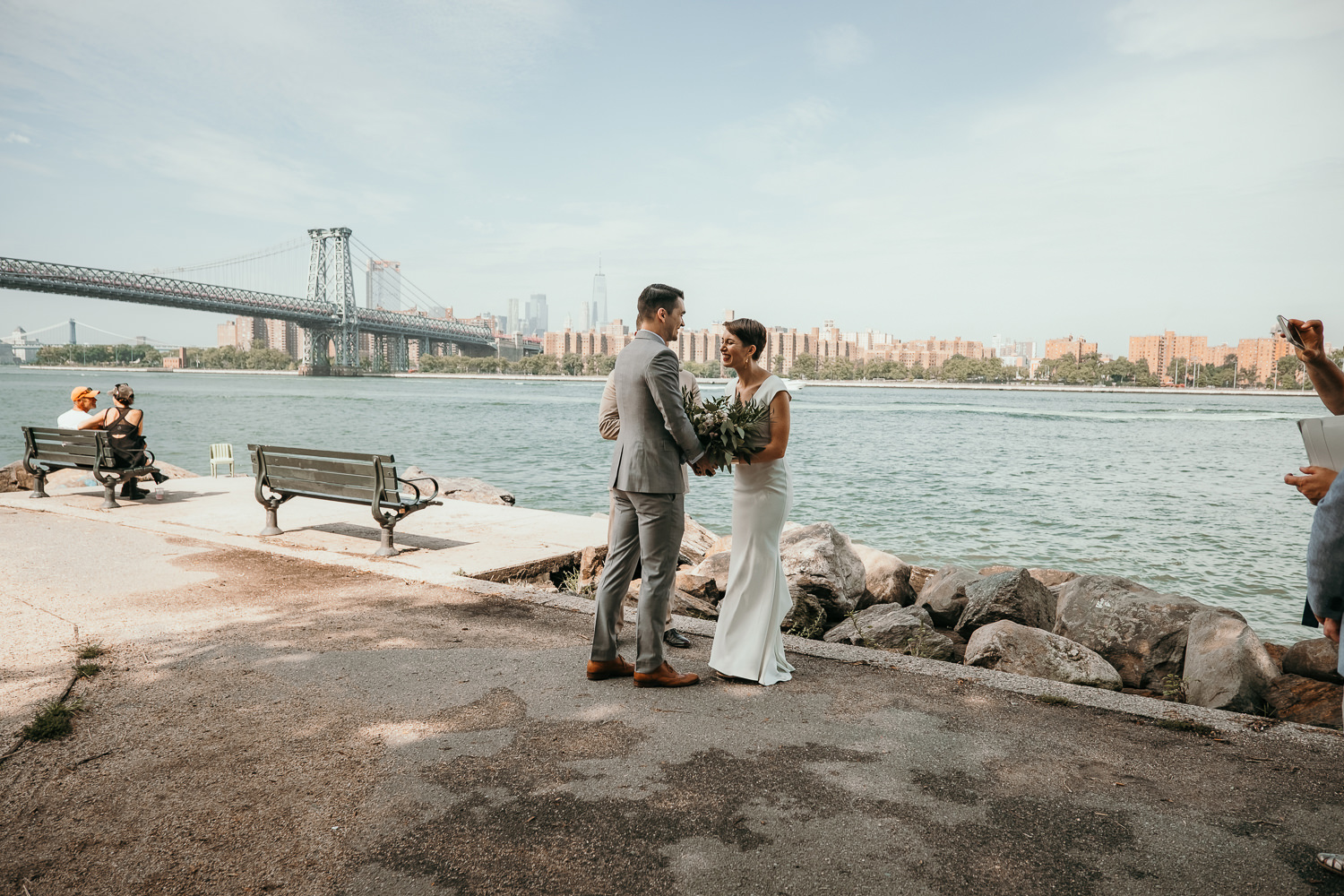 wide of entire ceremony scene bride laughing Williamsburg bridge view
