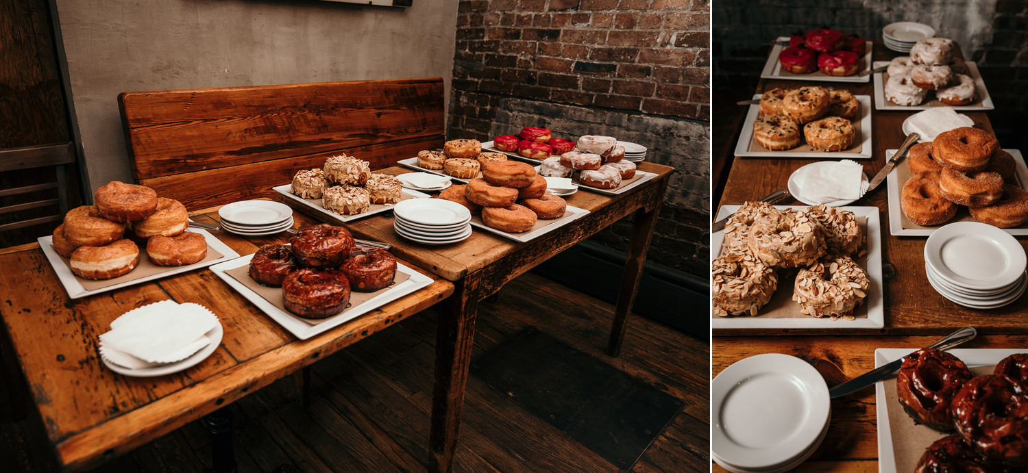 wooden table with plates each with different kinds of colorful donuts