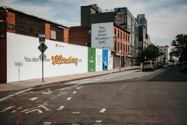 street corner white wall Williamsburg written in yellow