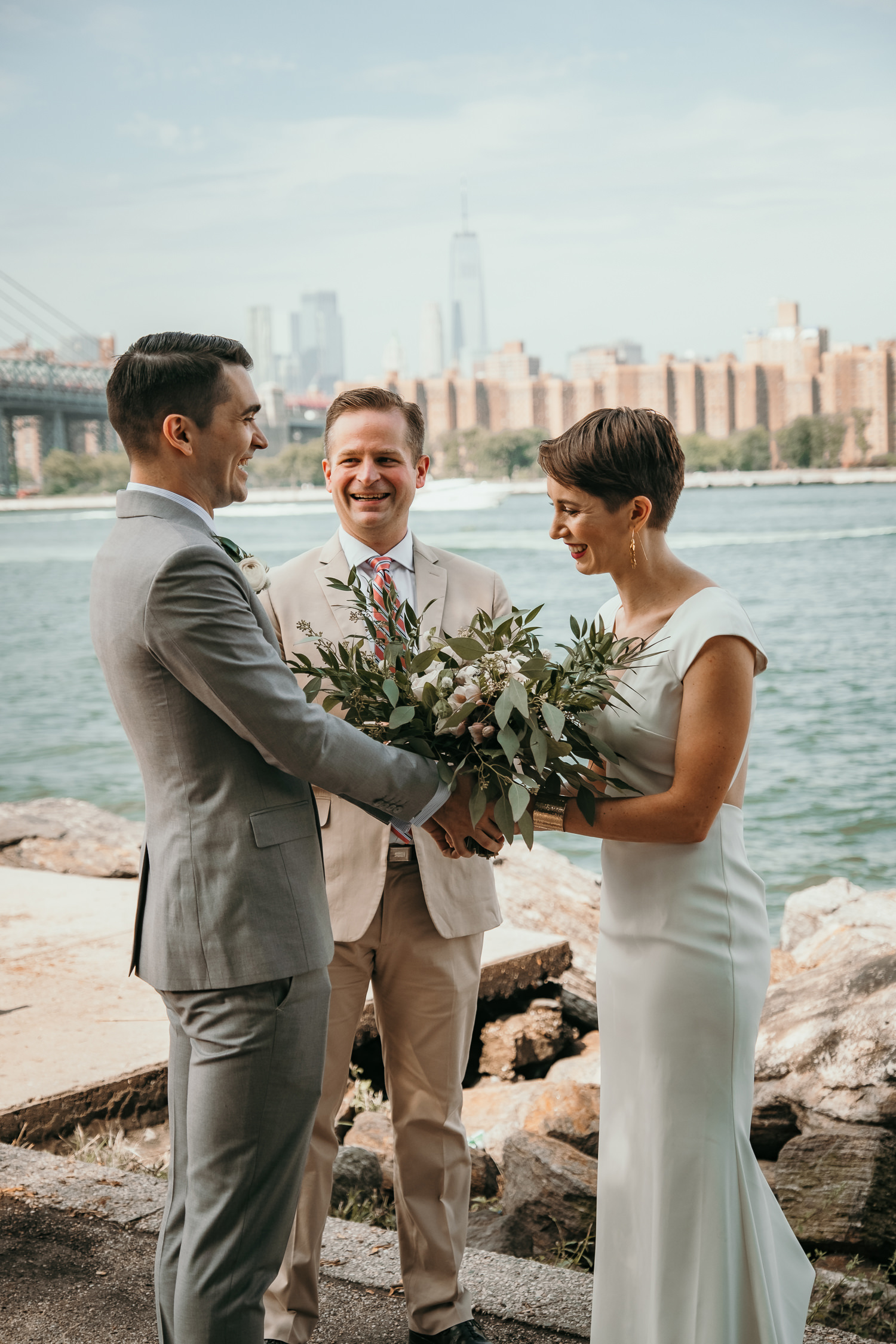 close up of couple holding flowers during ceremony Williamsburg bridge
