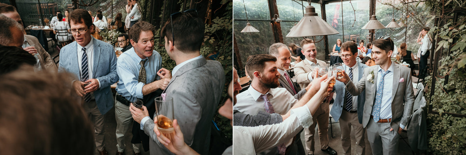 groom and family members cheering and taking a shot