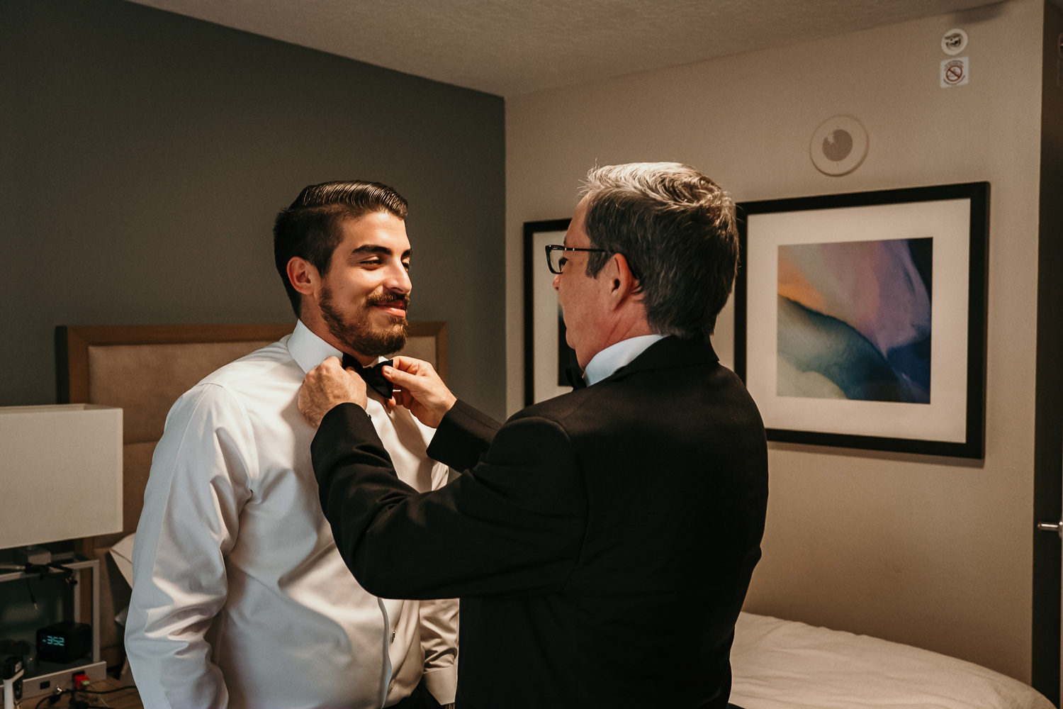 grooms father fixing grooms bowtie