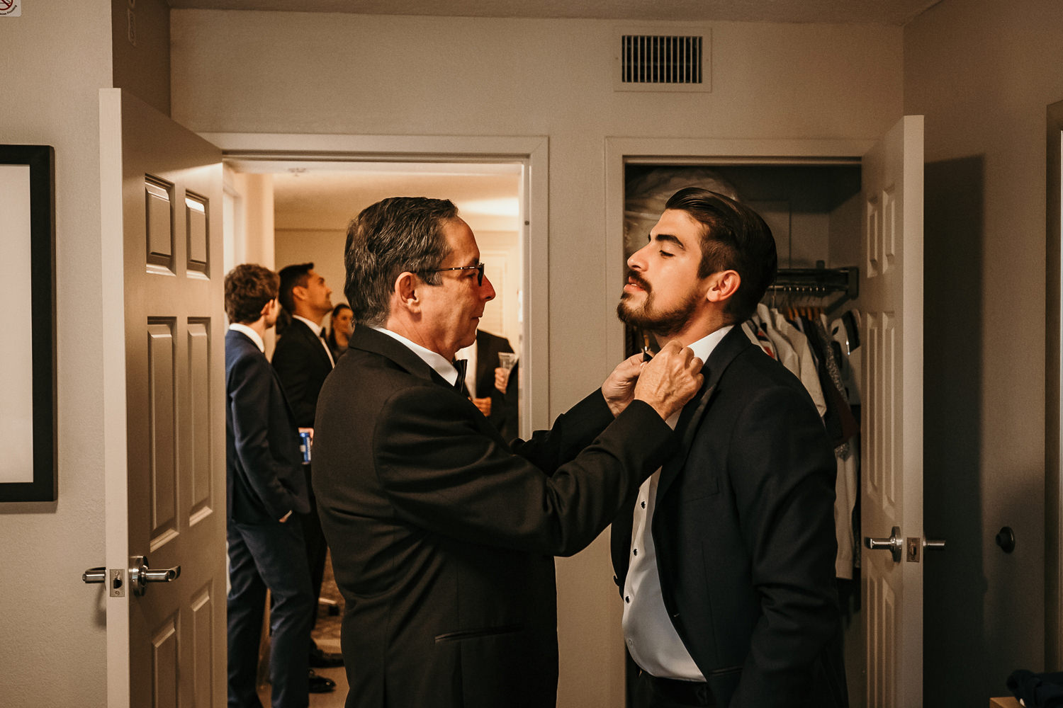 dad fixing grooms bowtie