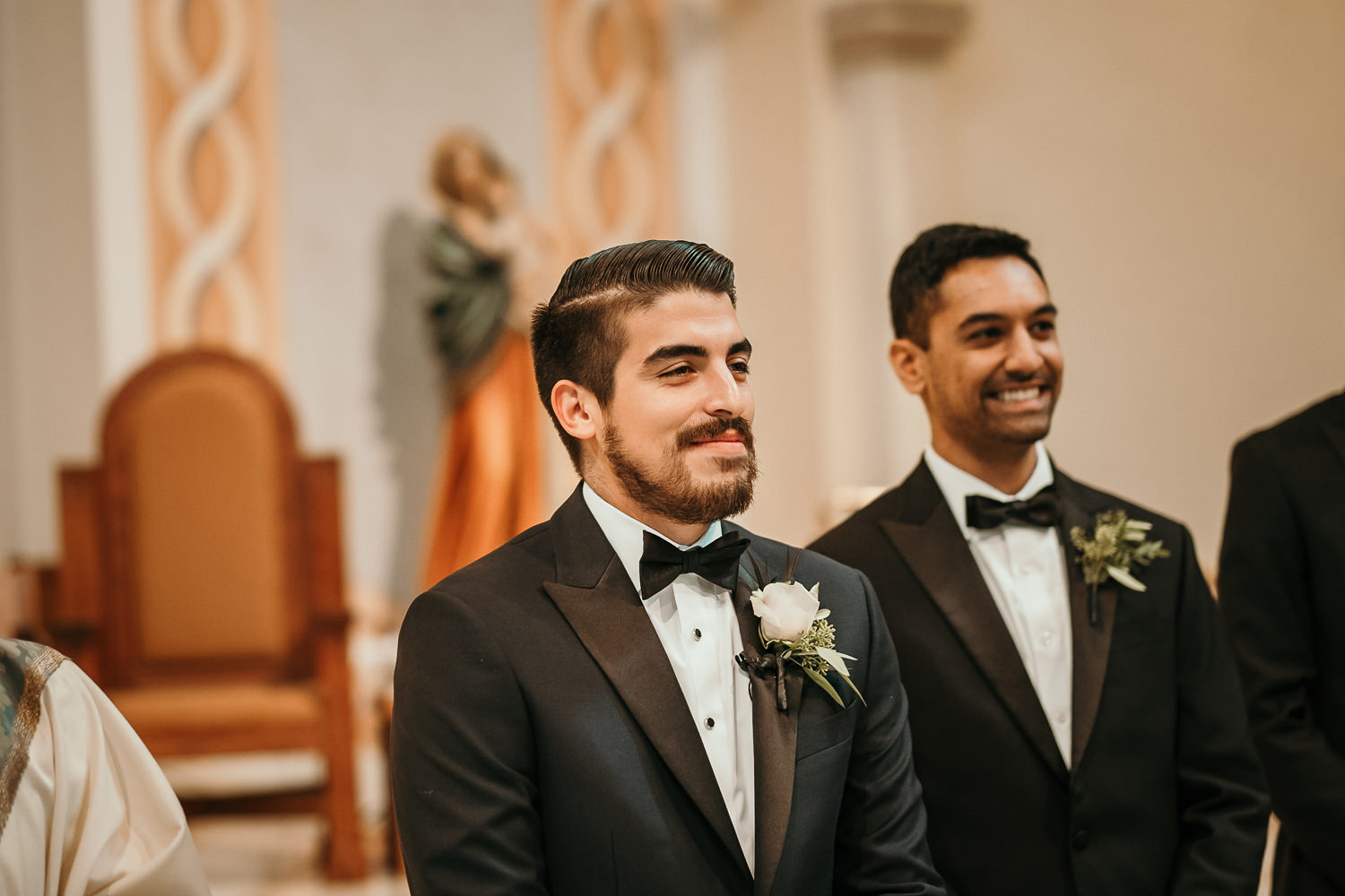 close up of groom smiling waiting on his new bride