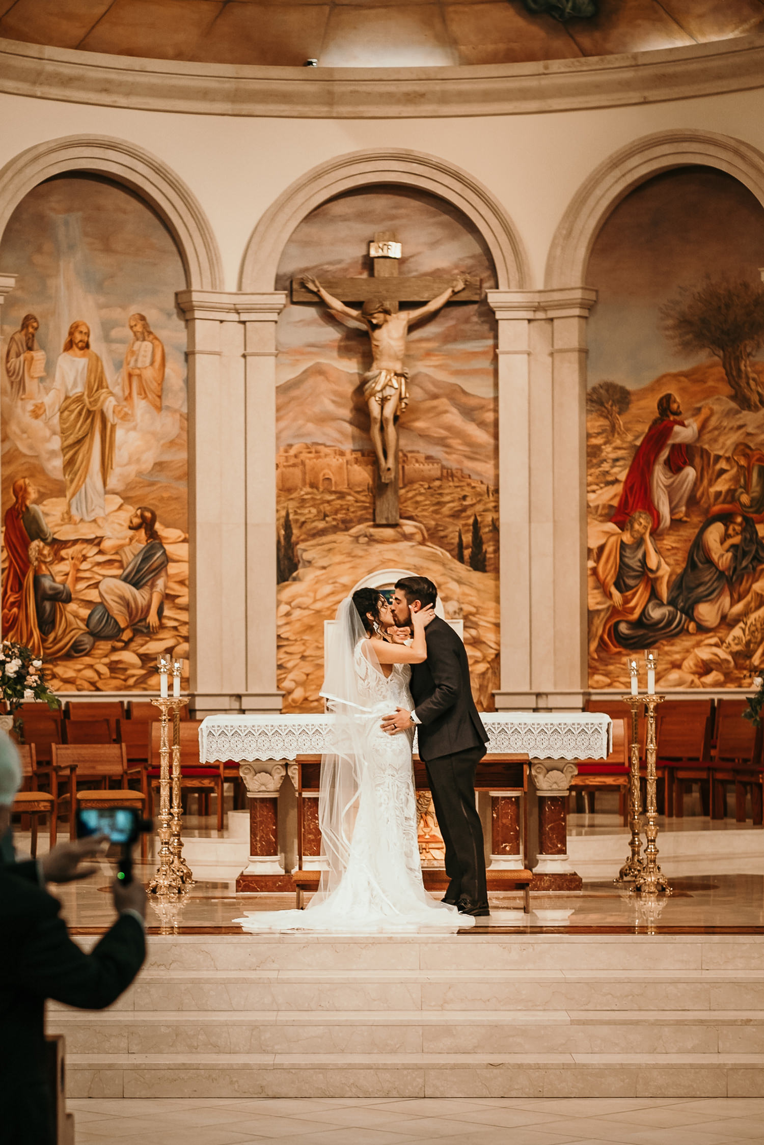newlyweds first kiss at church altar