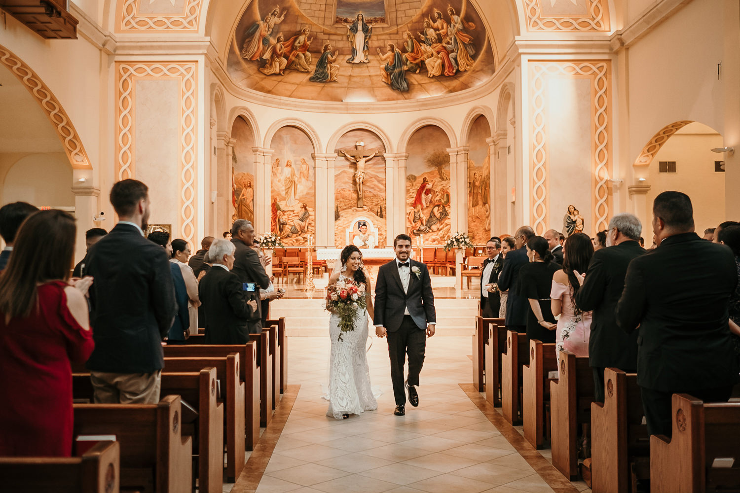 newlyweds start to walk down church aisle