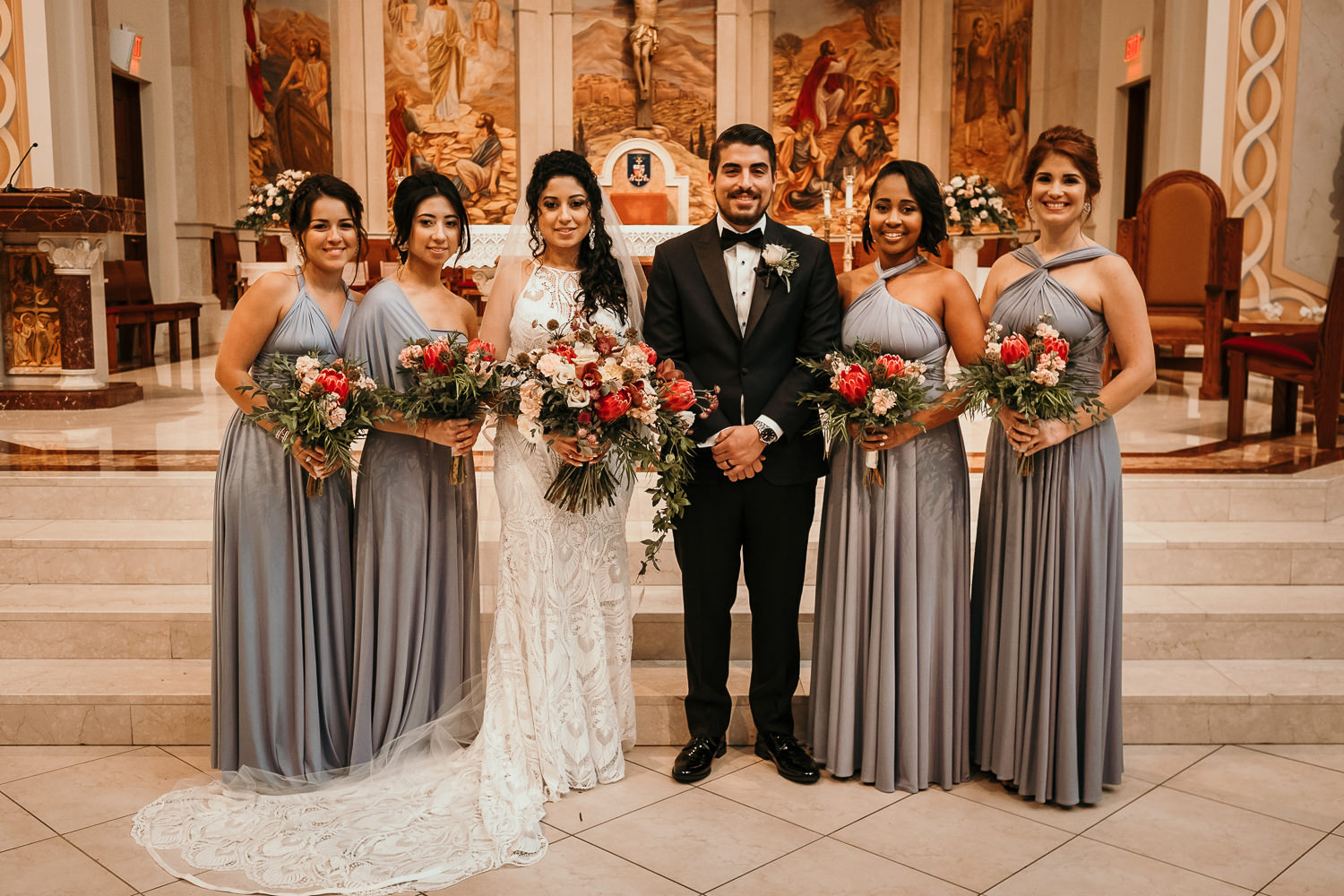 bridal party posing on church altar
