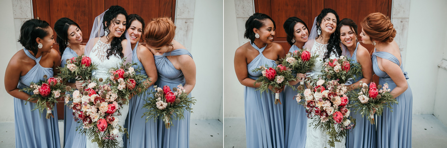 bride and bridesmaids close together laughing