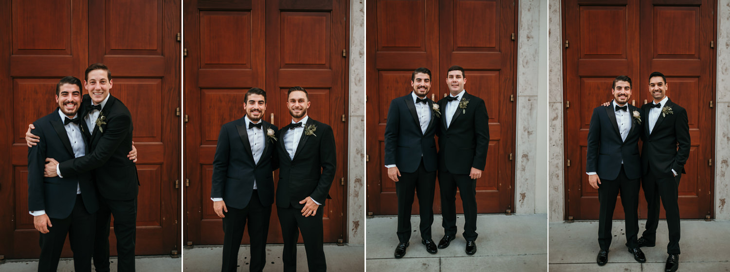 groomsmen outside of wooden church doors
