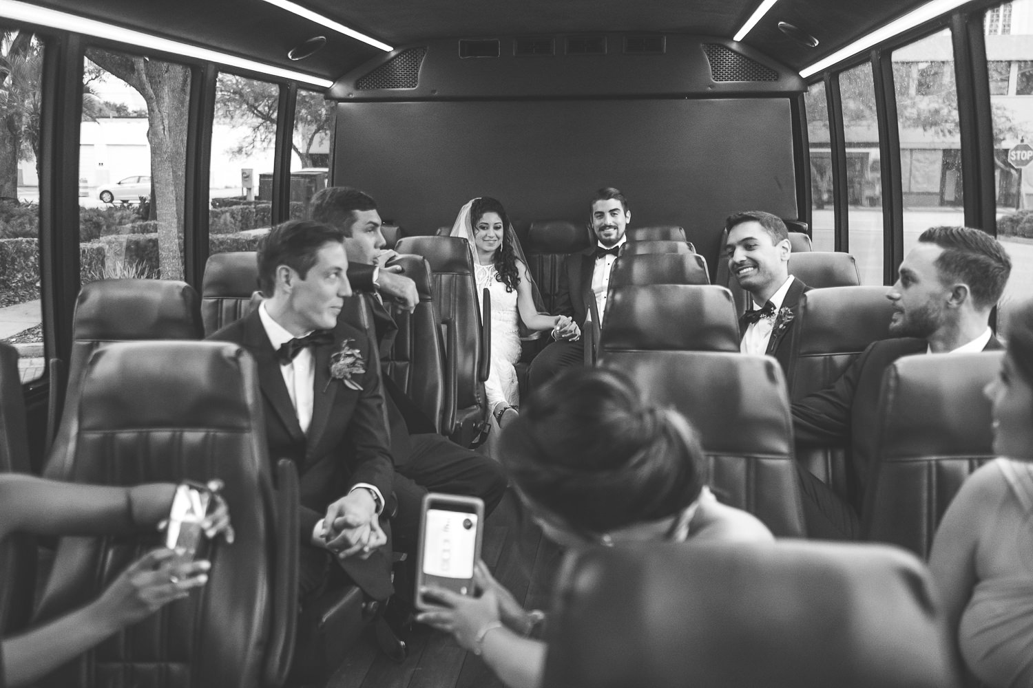 bridal party on party bus taking selfies