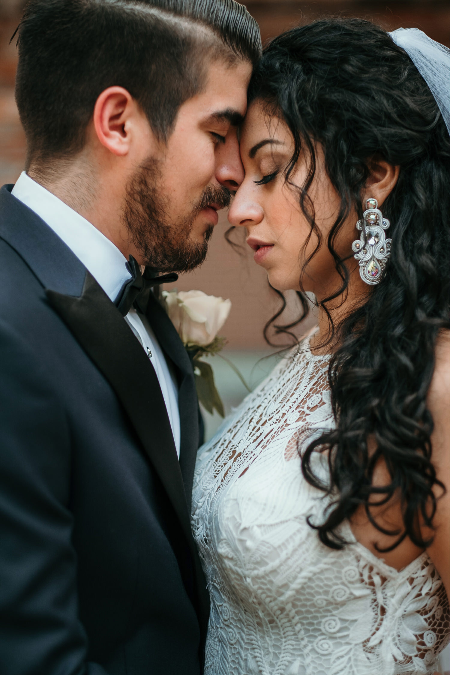 close up of bride and groom with foreheads together