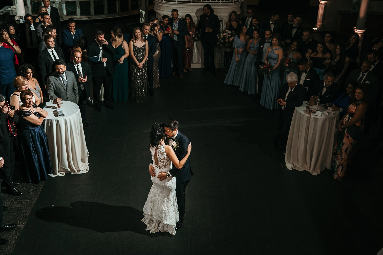 newlyweds hugging middle of dance floor during first dance