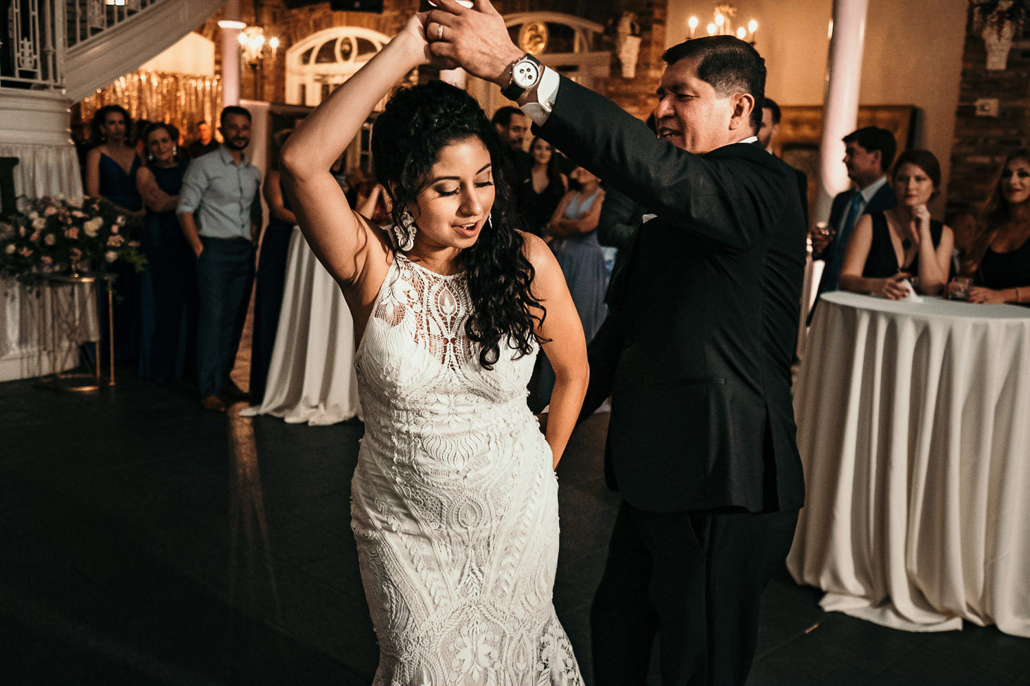 father spinning bride during father-daughter dance
