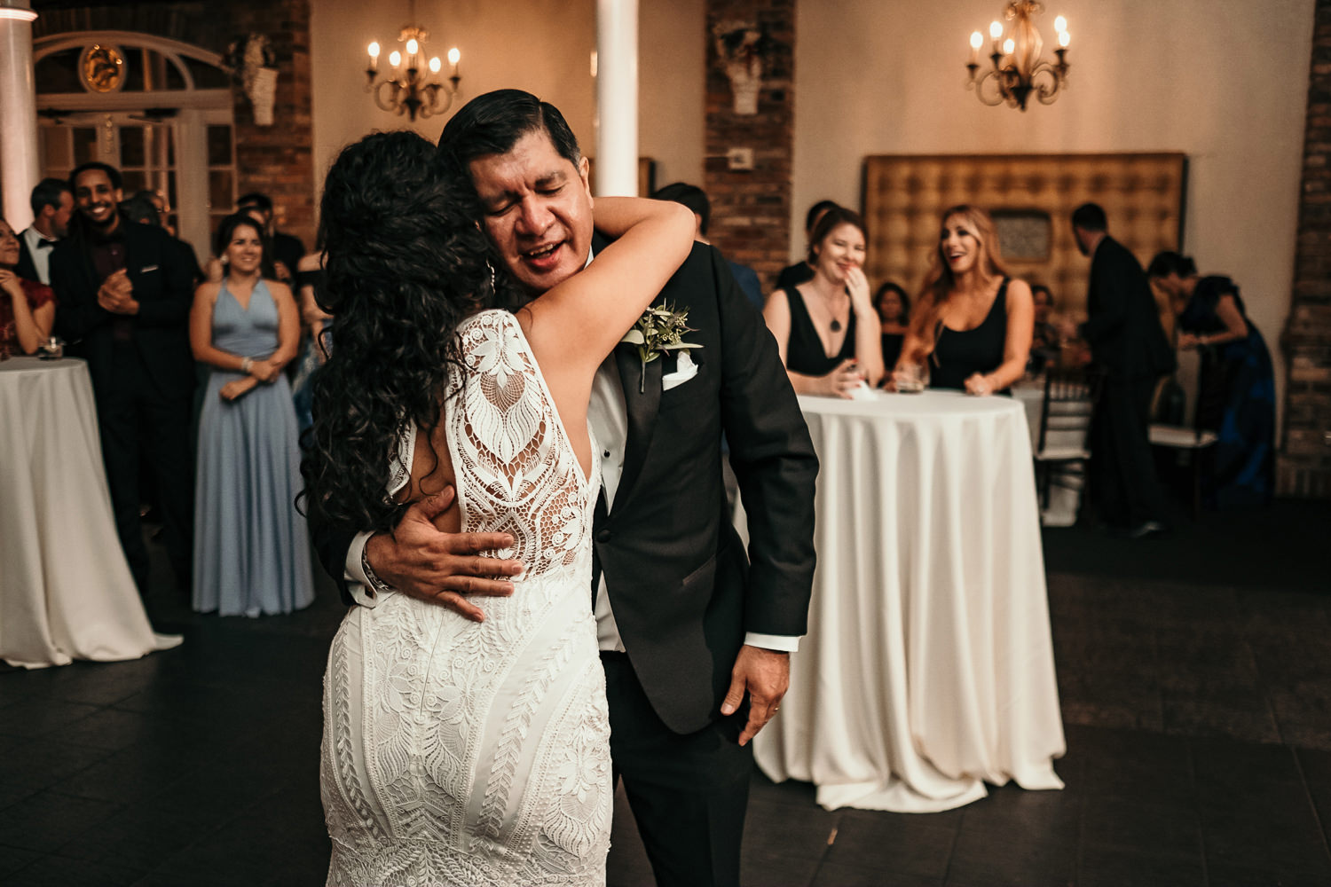 dad hugging bride during father-daughter dance