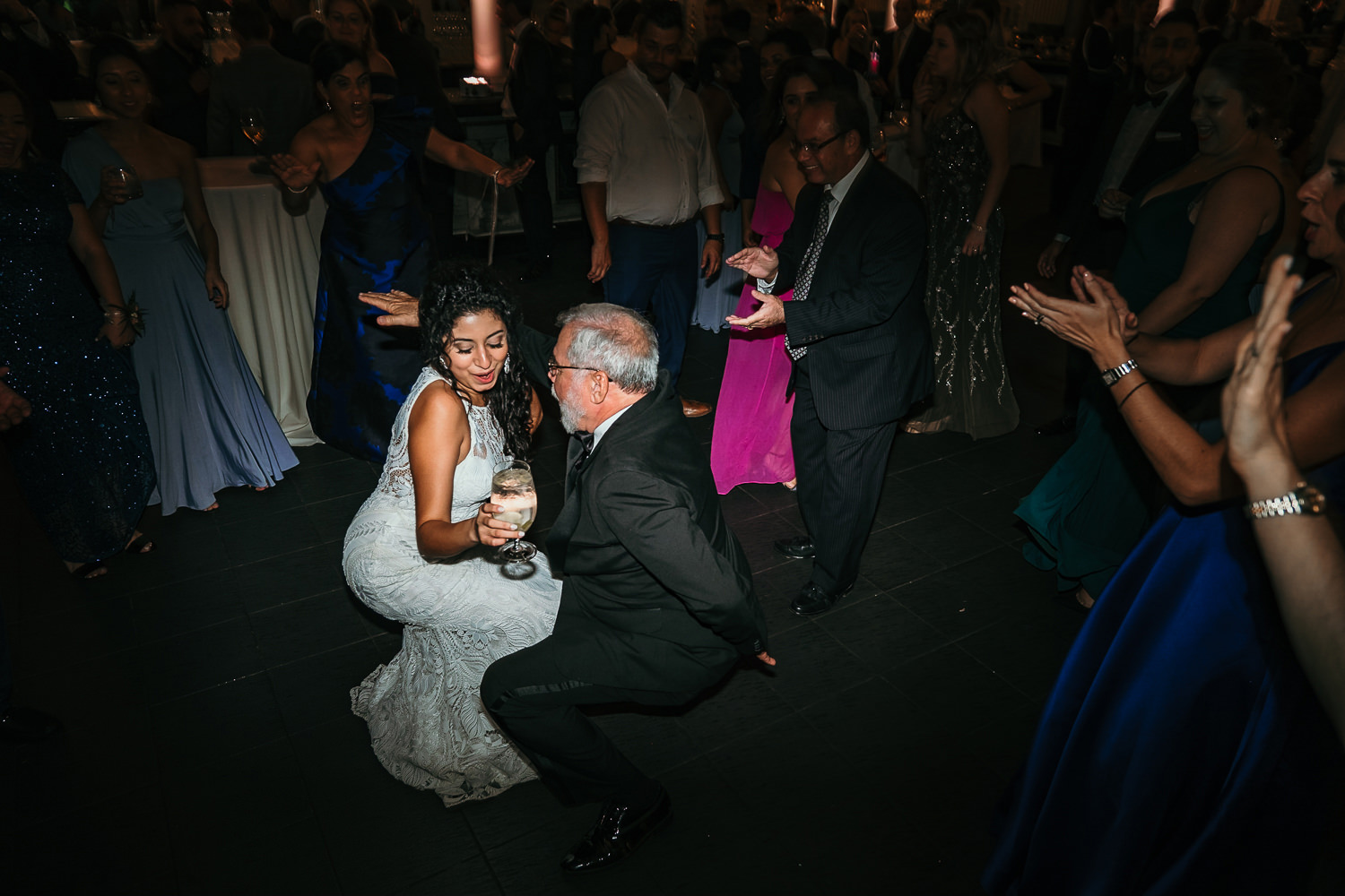 bride and older relative dancing low