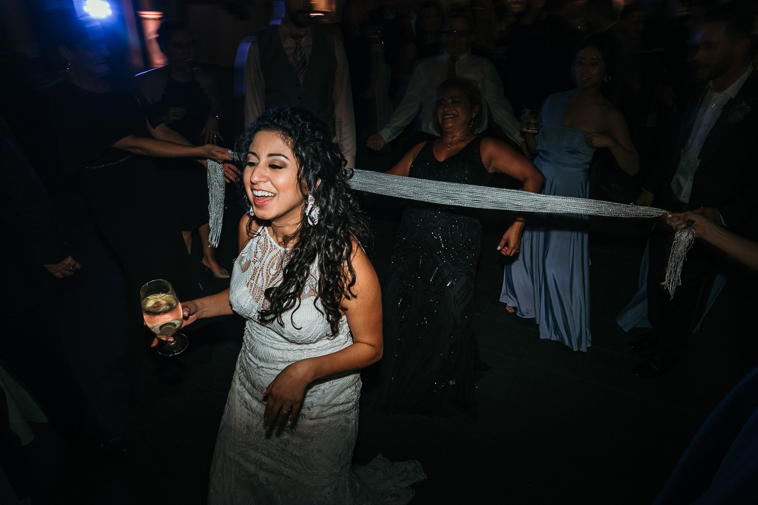 bride dancing holding drink