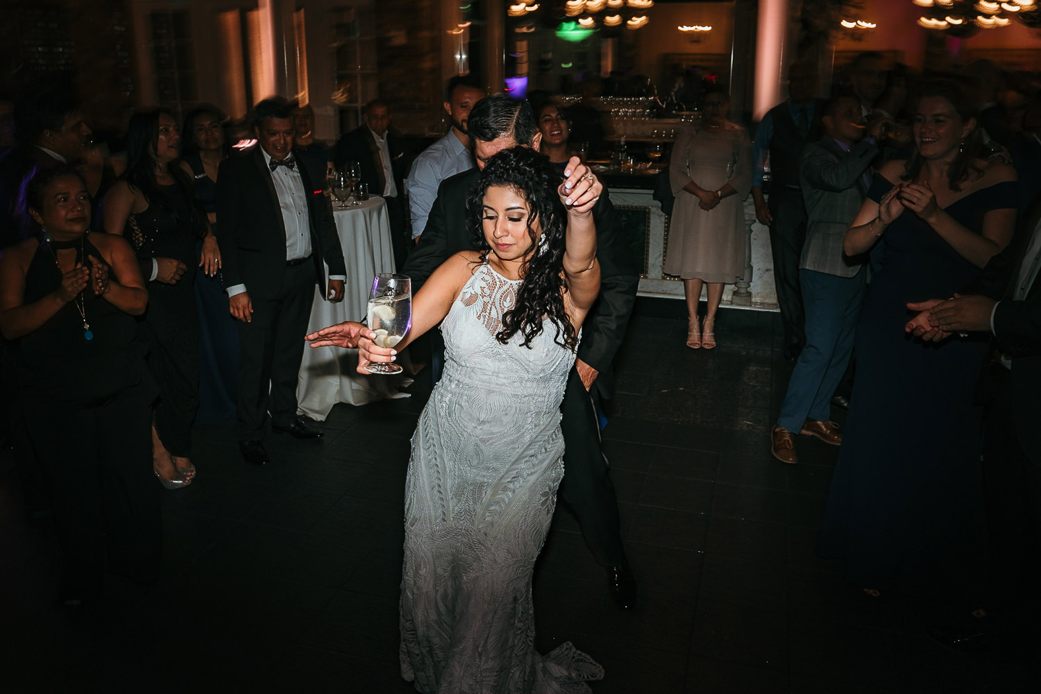 bride dancing snapping fingers holding drink