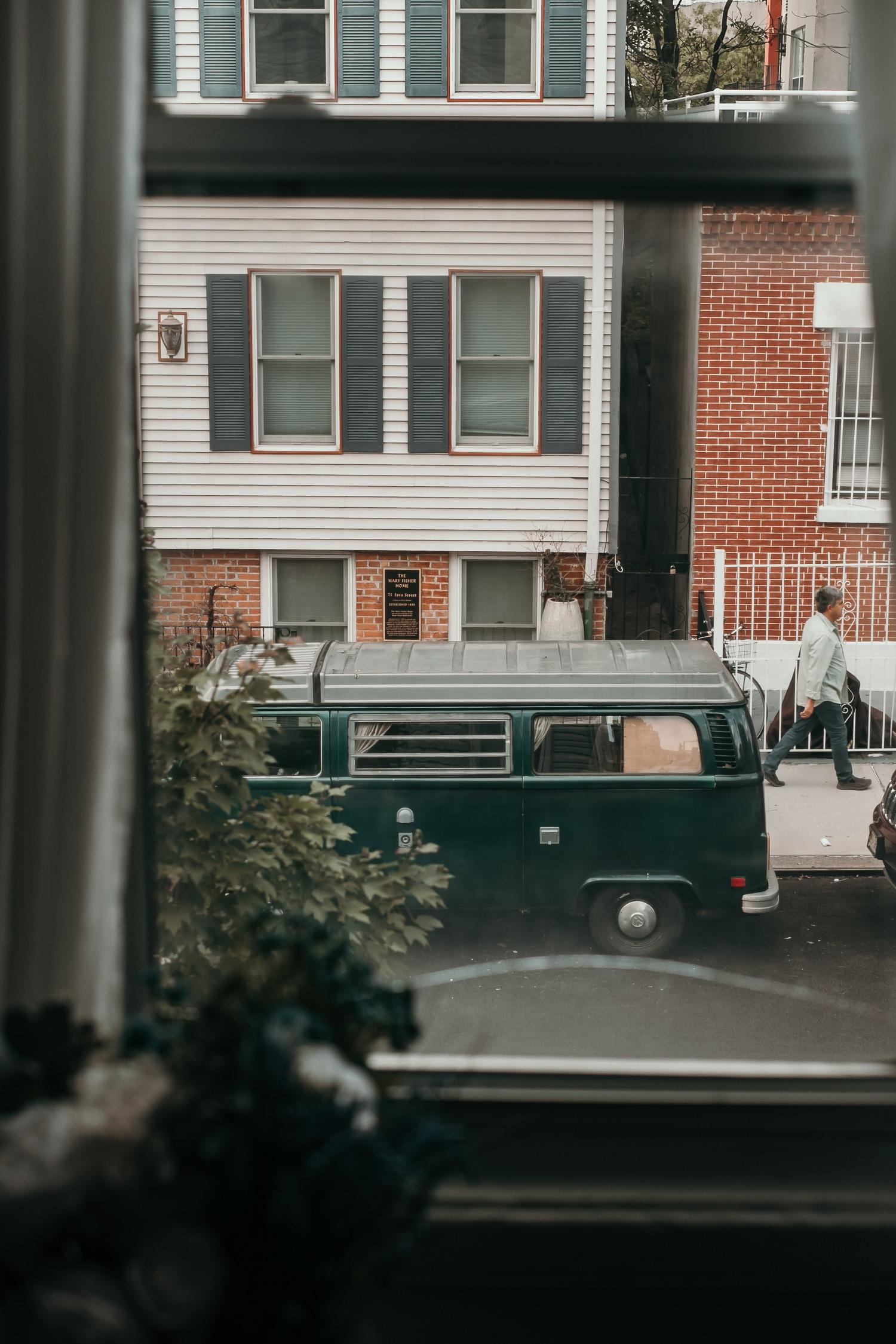 Brooklyn street view from window man walking by
