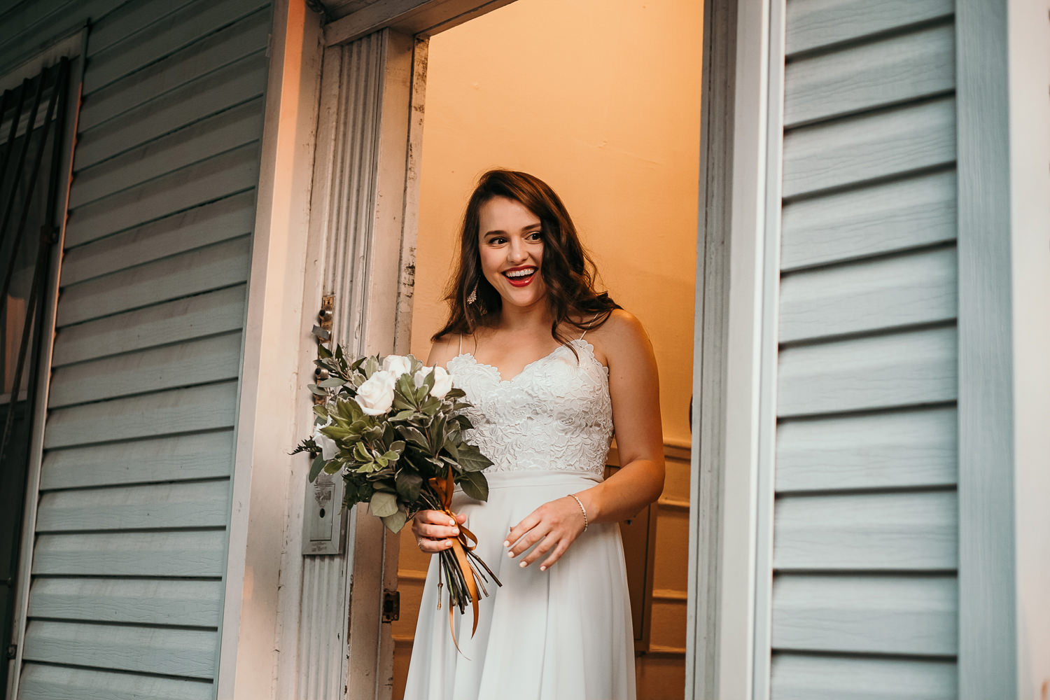 bride surprised face as she walks out apartment door