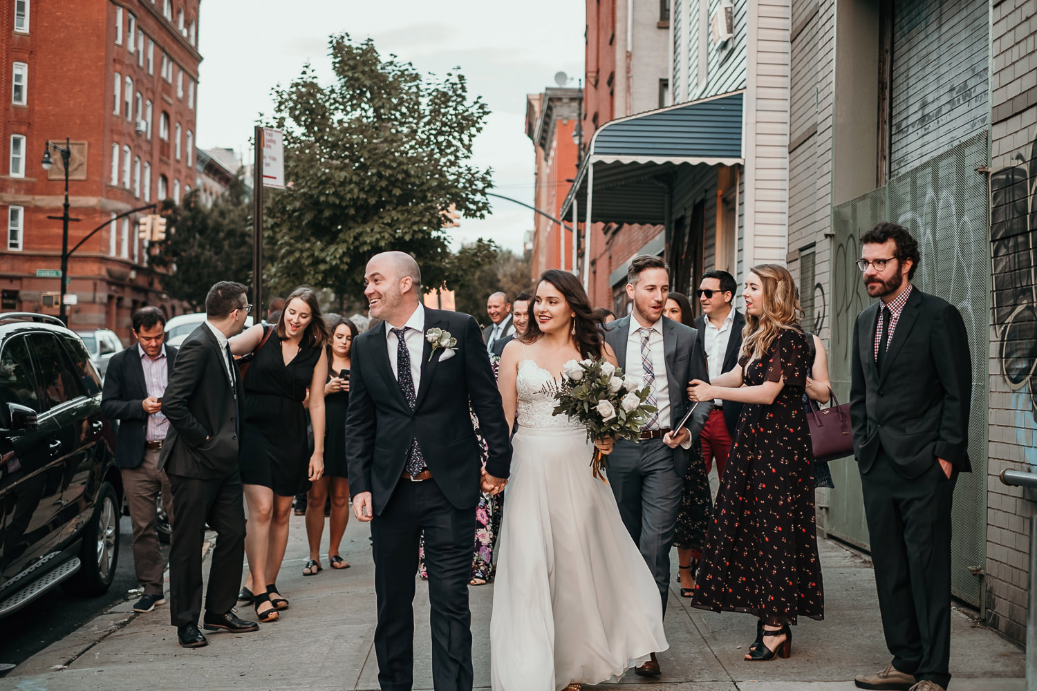 wedding party walking in Brooklyn towards the park