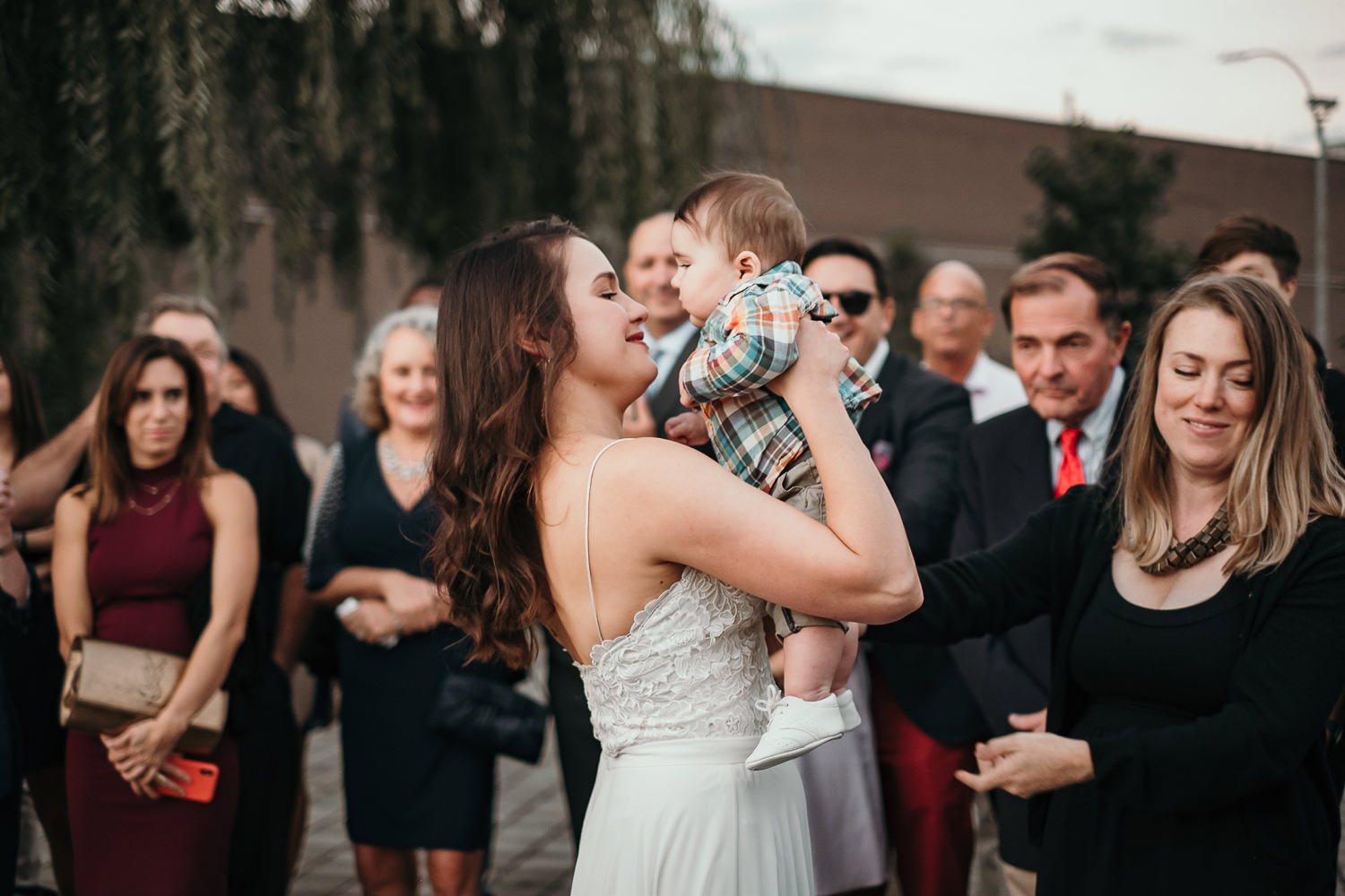 bride picks up baby during ceremony