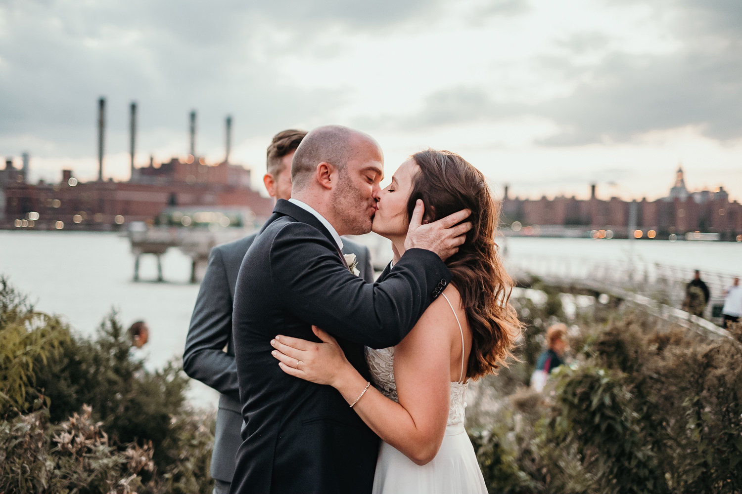newlyweds first kiss New York city view in background