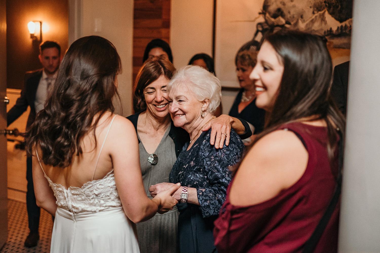 grandmother holding brides hands