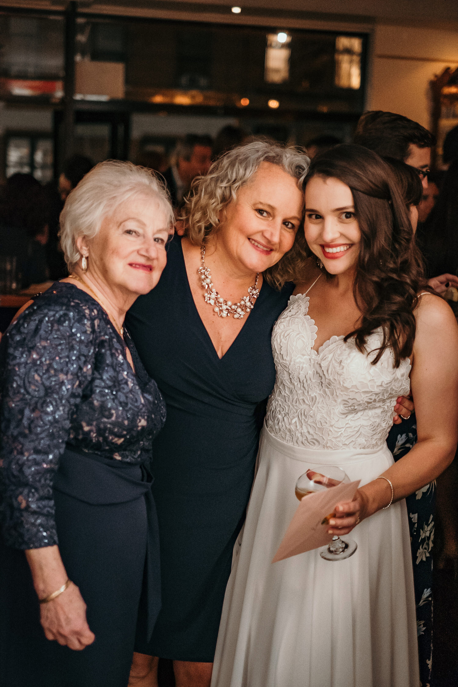 three generations mother grandmother bride posing smiling
