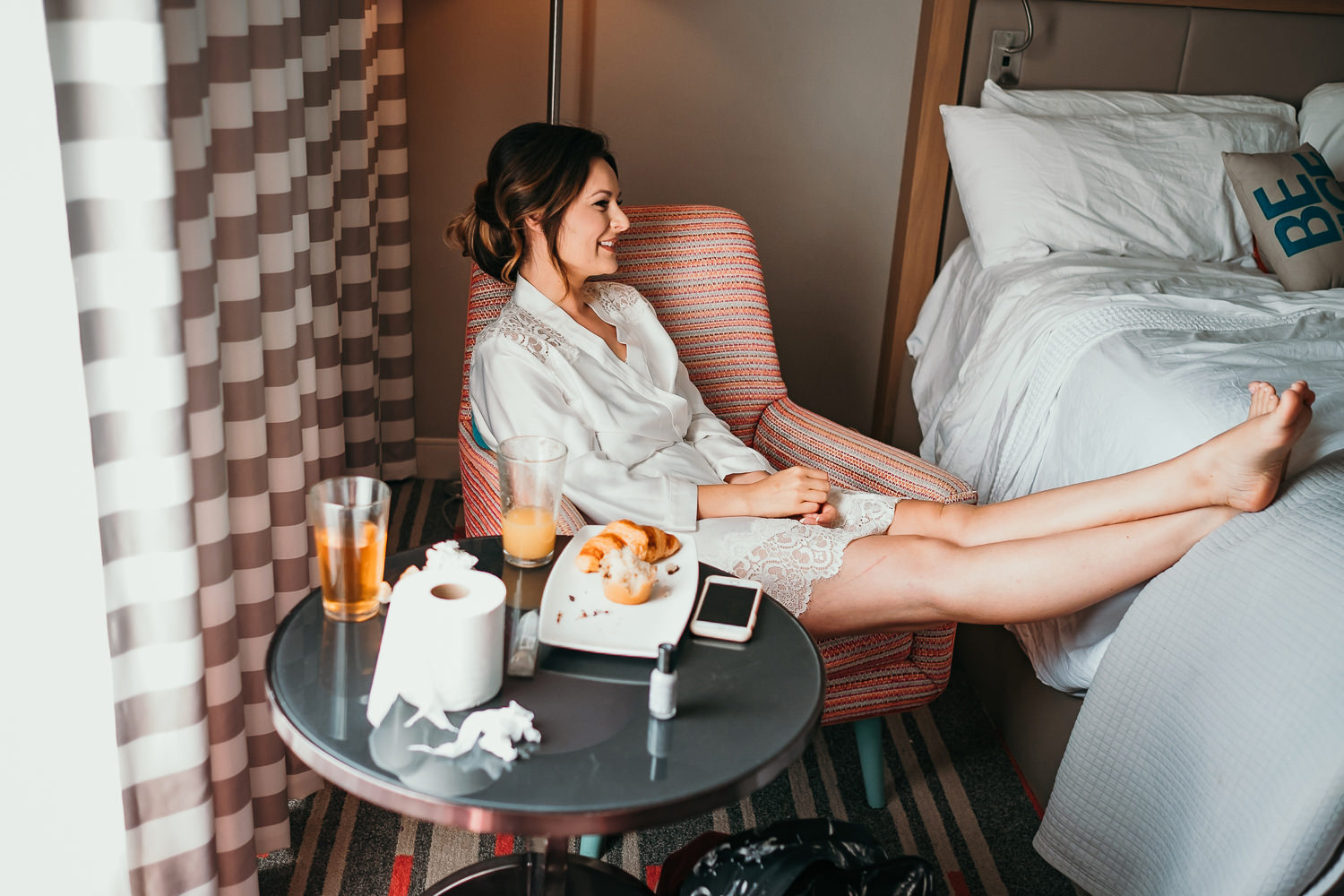 bride relaxing with feet on the bed