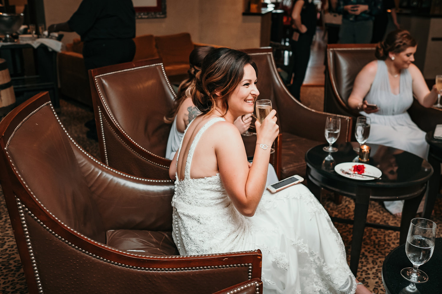 bride smiling with champagne in hand