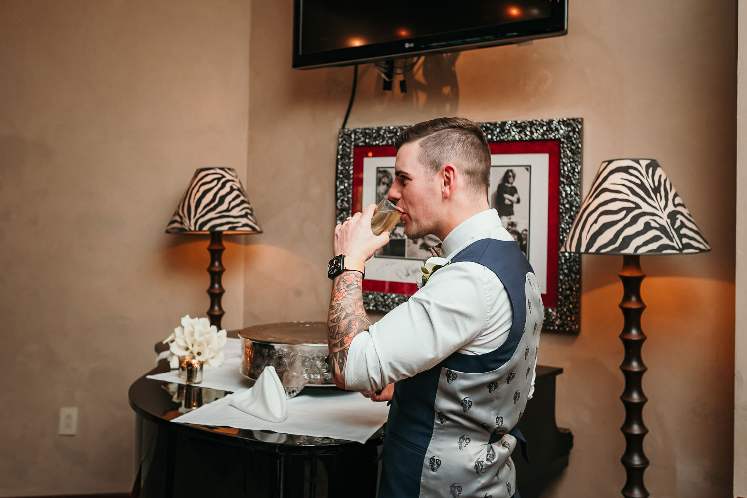 groom drinking champagne