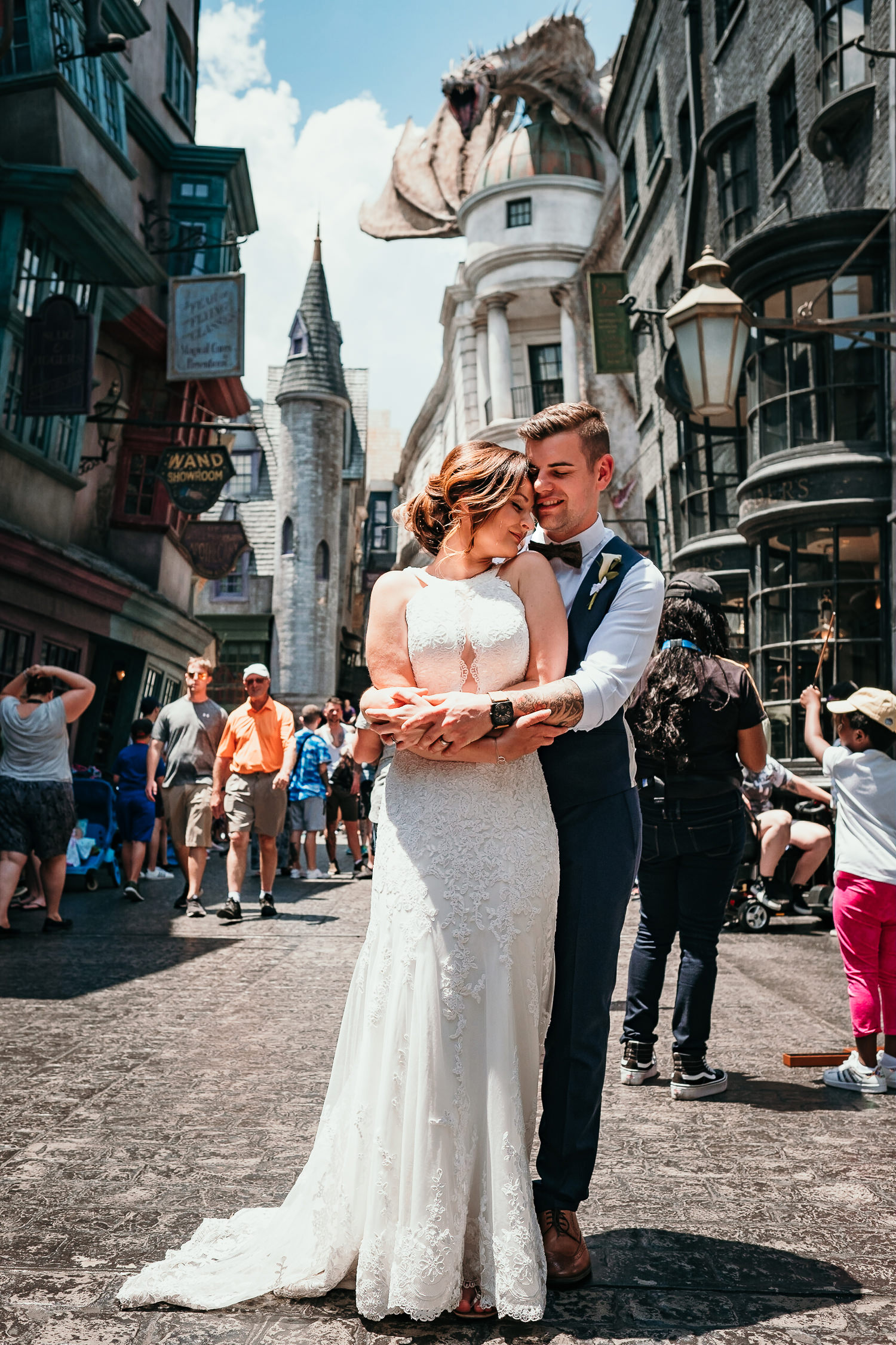 newlyweds hugging with gringotts dragon as the background