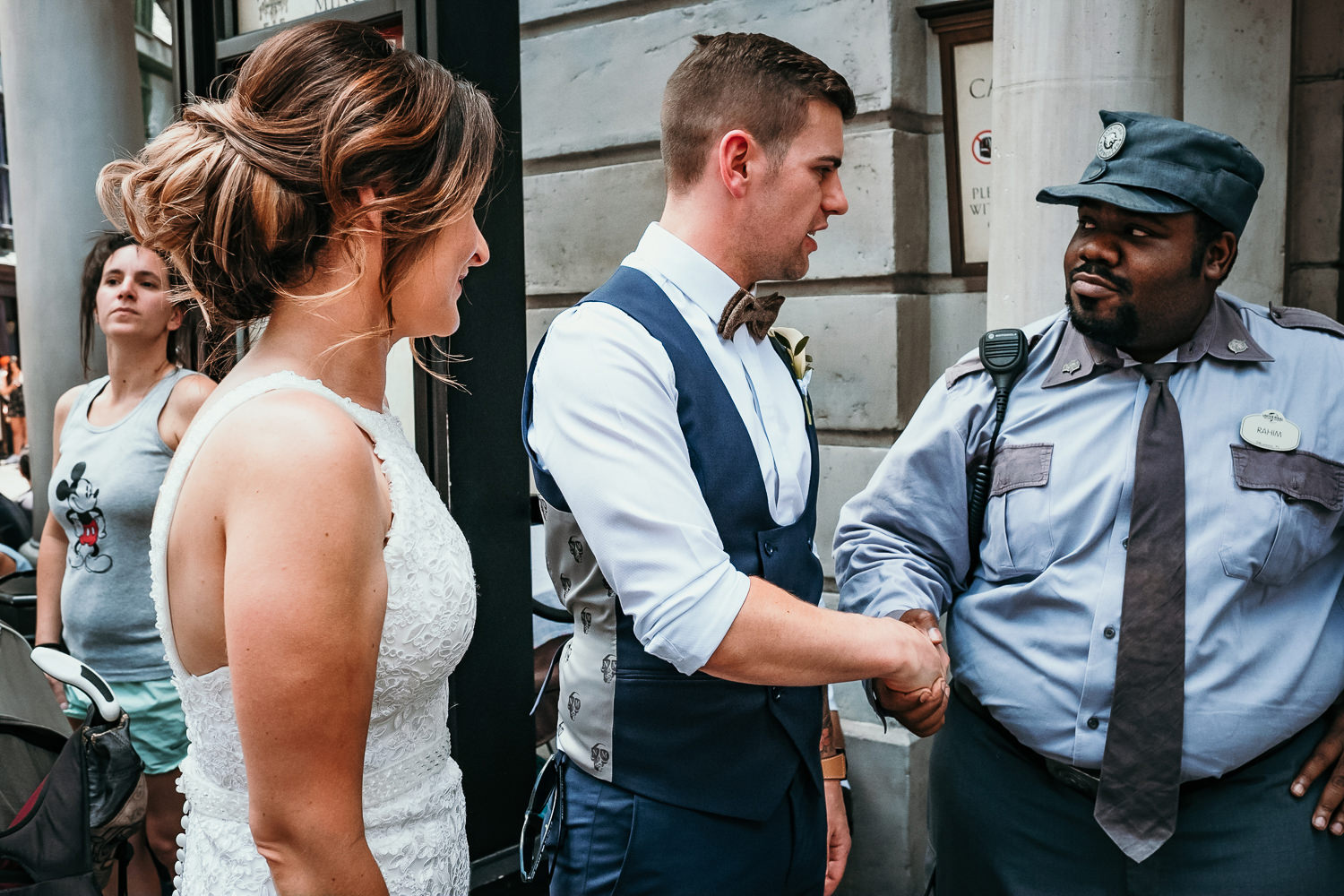 groom shaking hands with gringotts security