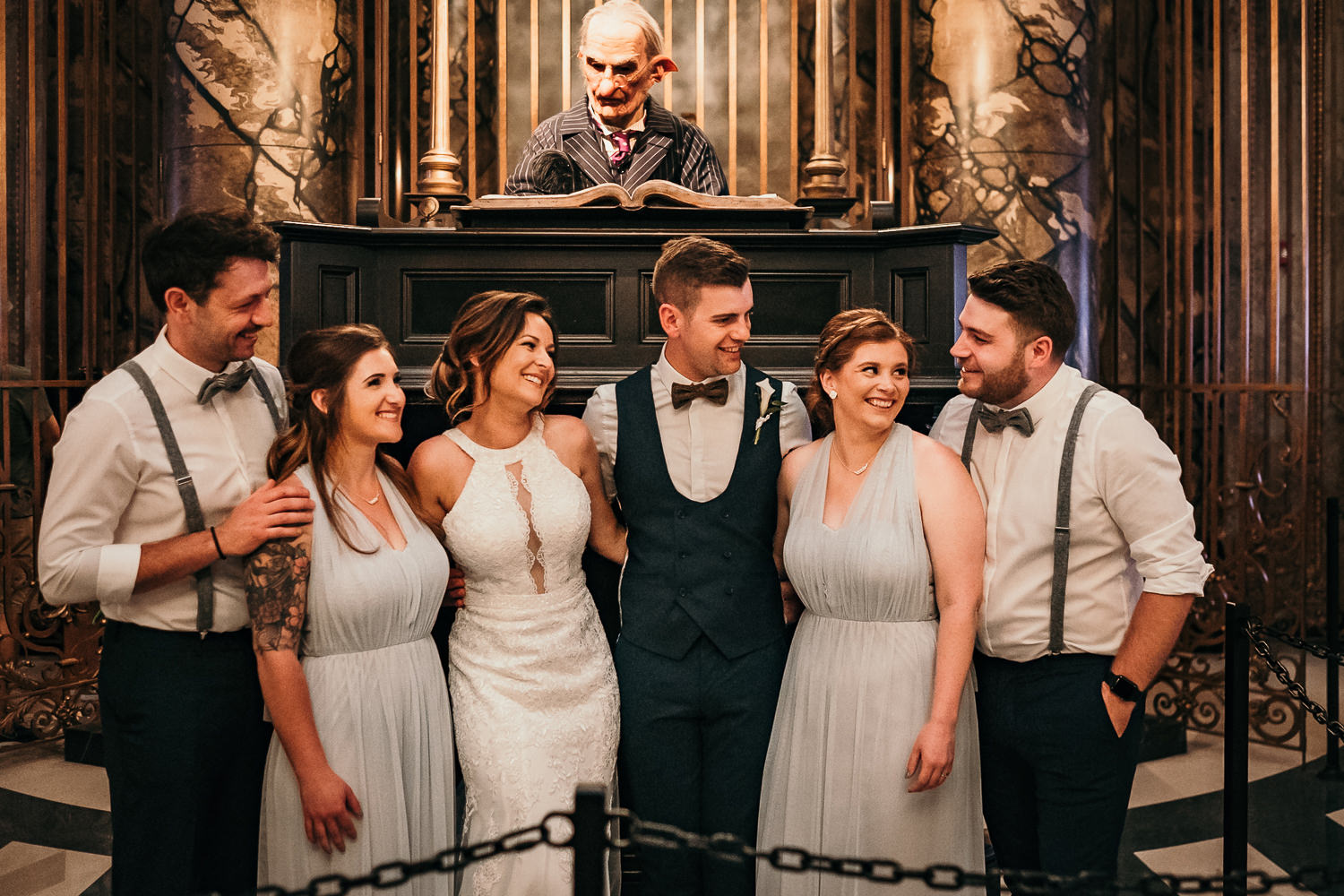 wedding bridal party in front of gringotts elf
