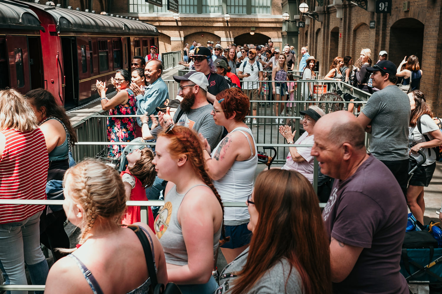 crowd at hogwarts express applauding the newly married couple