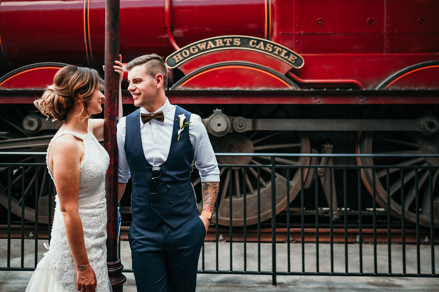 close up of newlyweds posing in front of hogwarts express train