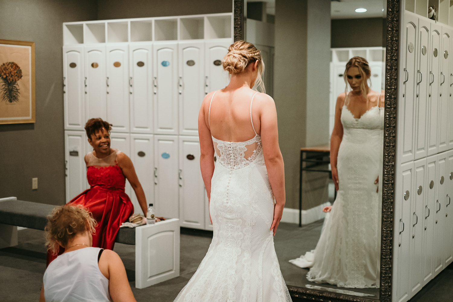 ladies locker room bride checking dress in front of mirror