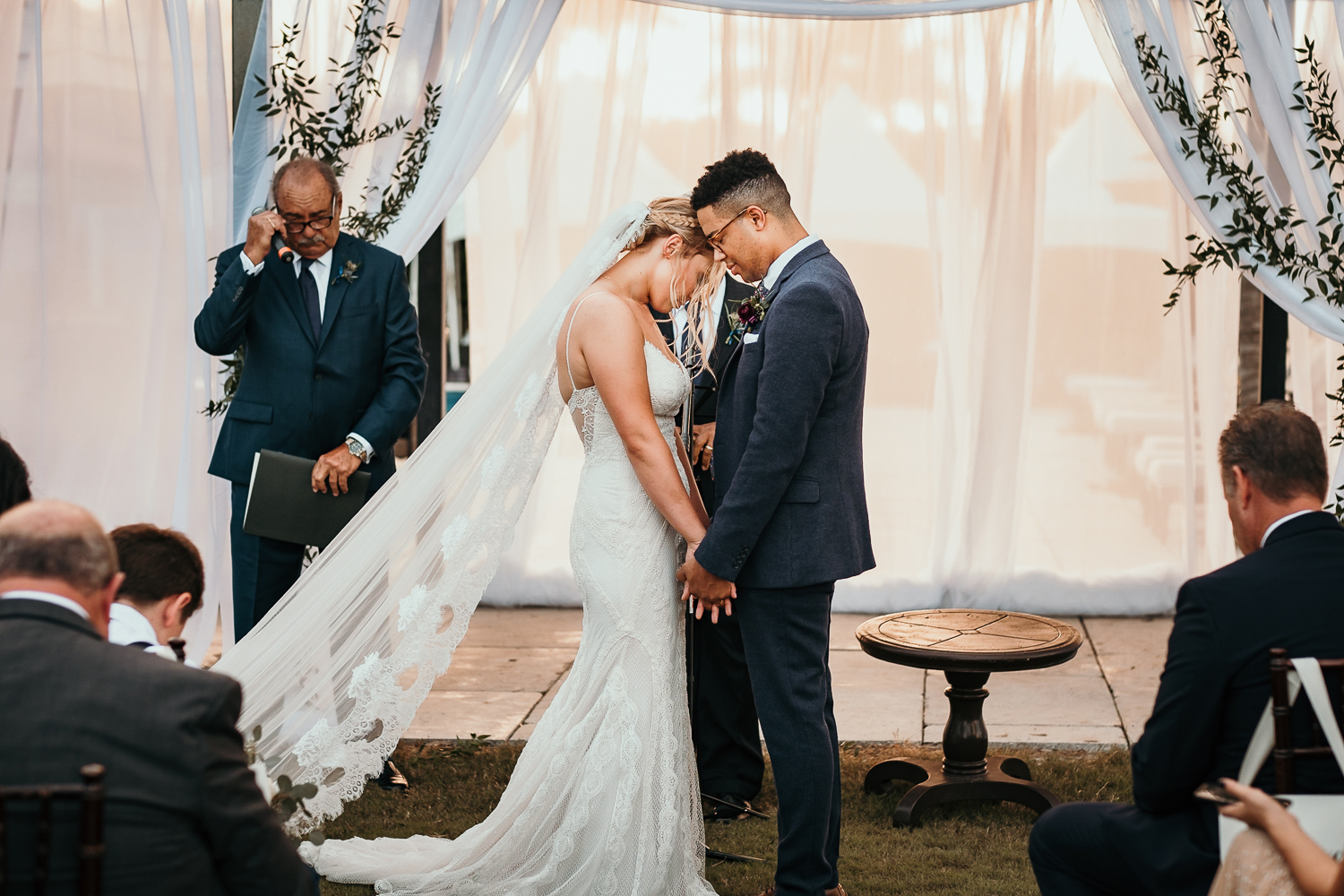 bride and groom heads touching praying together very intimate